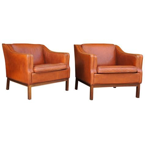 upholstered club chair a pair of danish modern leather upholstered club chairs