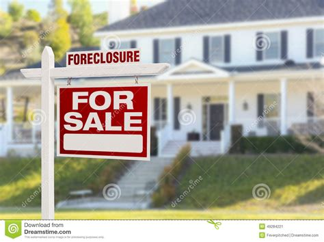 mortgage house for sale foreclosure home for sale sign in front of large house