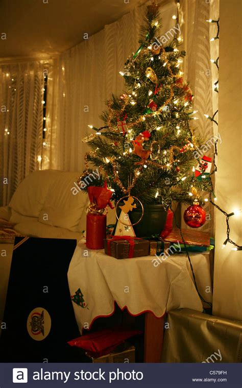 google holiday living mini christmas trees small tree on table in glowing living room with lights and stock photo royalty free
