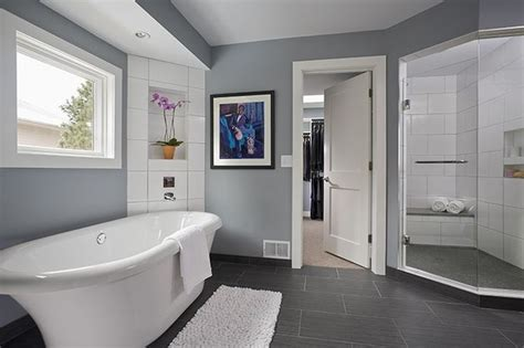 soft gray paint soft gray paint color in this modern large bathroom design with a unique standalone bathtub