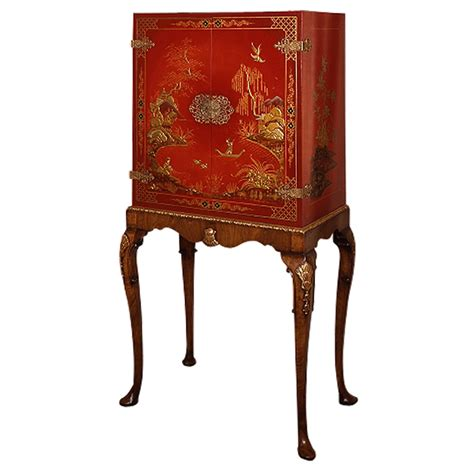 red lacquer cabinet red lacquer cabinet on walnut parcel gilt stand