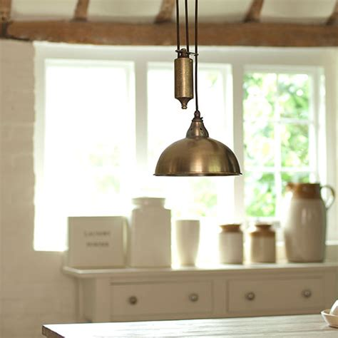 rise and fall pendant light 8 pendant lights to brighten your country kitchen
