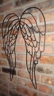 garden wall decor wrought iron wrought iron wings wall decor garden decor world