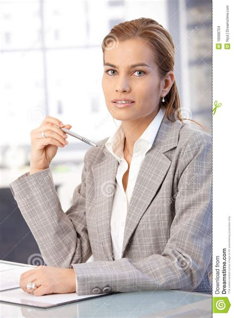 pretty businesswoman sitting at desk stock images image