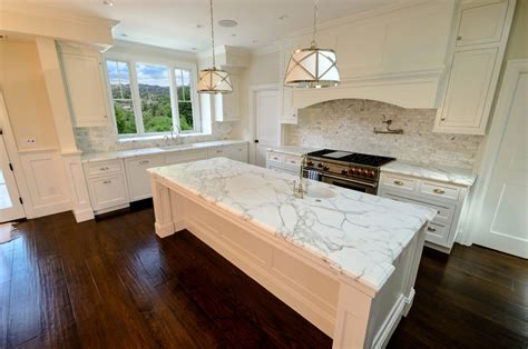 Calacatta oro marble kitchen contemporary with white cabinets with white marble la