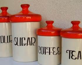 vintage ceramic kitchen canisters running with a glue gun vintage canisters