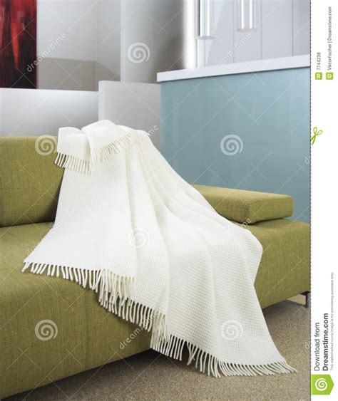 draped over white throw draped over a settee royalty free stock photos