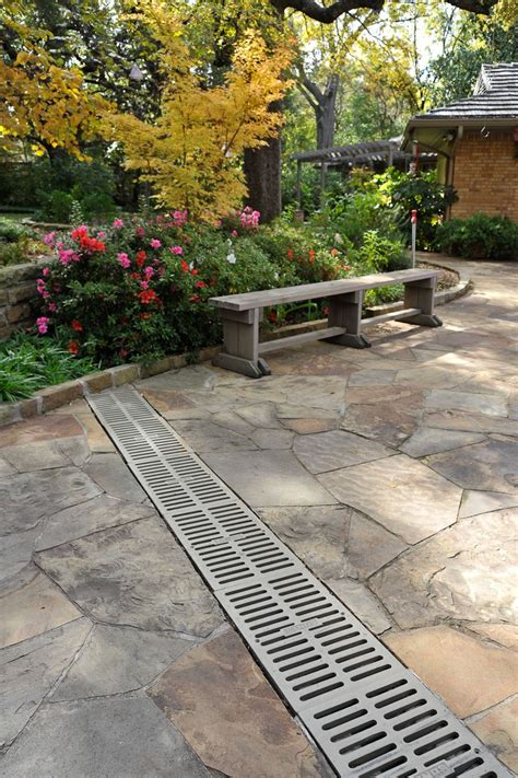 Patio Drainage Ideas by A Channel Drainage System Around The Perimeter Would Be