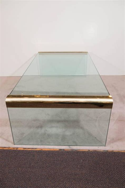 Glass Waterfall Coffee Table Pace Collection Glass Waterfall Coffee Table With Brass Trim At 1stdibs
