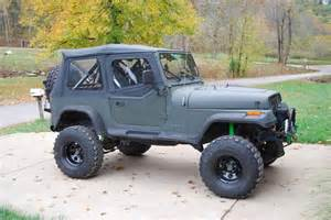 black lifted soft top jeep yj jeeps
