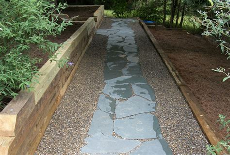 Using Landscape Timbers To Border A Driveway Timber Retaining Walls Welcome To Brady Landscapes