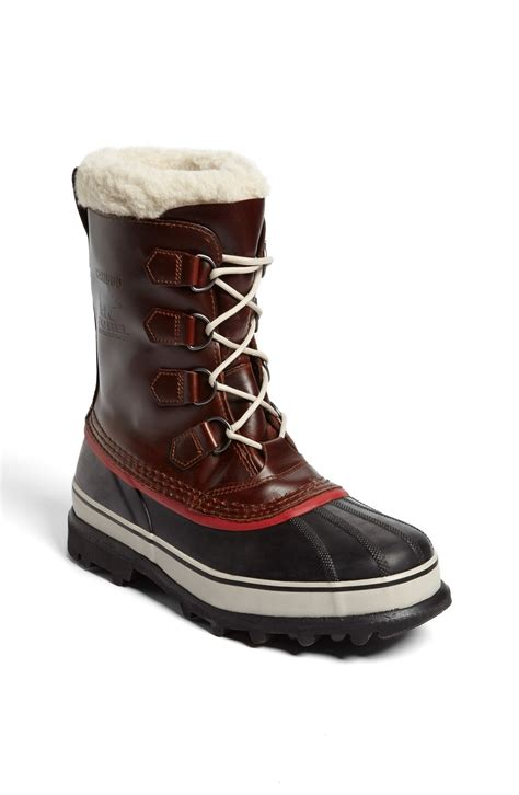 sorel snow boots sorel caribou snow boot in brown for burro lyst