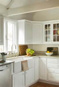lovely cottage style kitchen features white kitchen