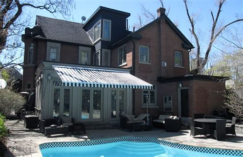 house awnings retractable canada awning by the pool of victorian style house rolltec