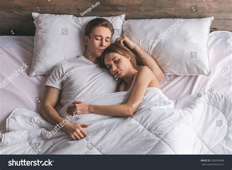couple sleeping together top view beautiful young couple hugging stock photo
