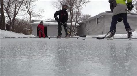 how to flood a backyard rink flooding a backyard ice rink image mag