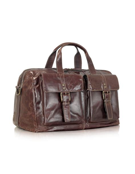 Fossil Me1121 Original Leather lyst fossil dayton genuine leather duffle bag in brown for