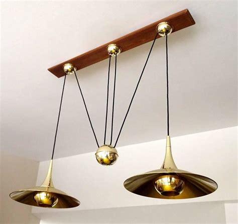 large pair brass counterweight pendant light modernist