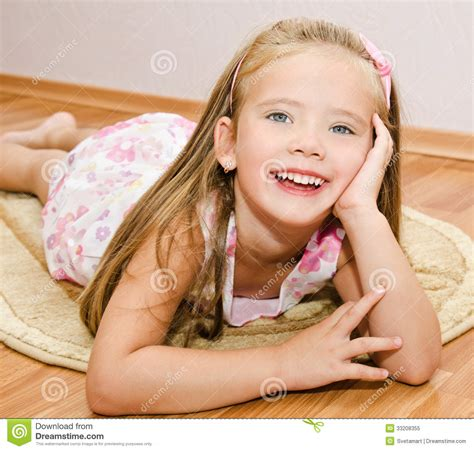 little girl house cute little girl lies on a house floor royalty free stock photo image 33208355