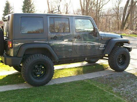 jeep jk steel wheels any pictures of a blue unlimited with black rims jk