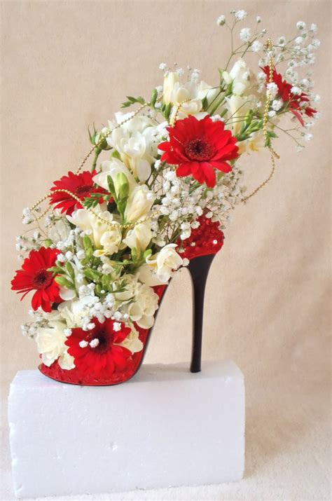flowers arrangement beautiful shoe design used as wedding display in different