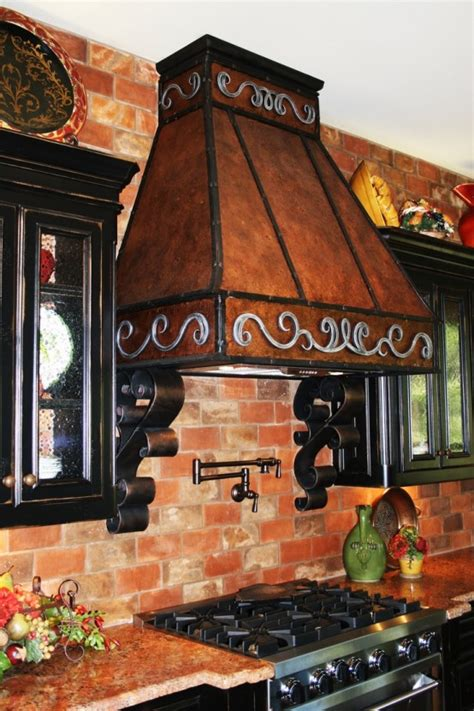 brick backsplash and copper hood would look great with 48 cool vent hoods to accentuate your kitchen design
