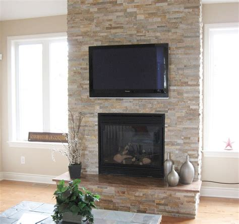 stacked stone fireplace pictures split stone fireplace with tv modern family room