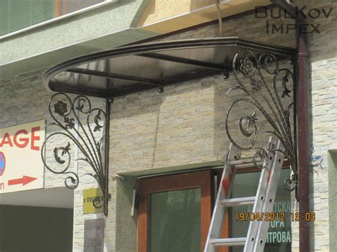 wrought iron awnings awning with wrought iron elements and polycarbonate