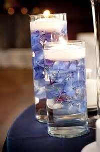 submerged blue hydrangeas floating candles candle