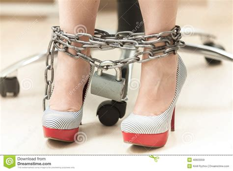 Photo of women legs in high heeled shoes locked by chain stock photo image 40603059