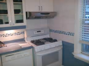 glass and ceramic tile backsplash