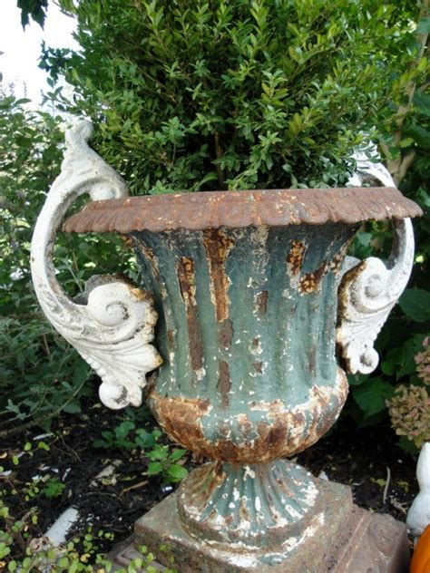 an antique urn with more elaborate designs and antique pair cast iron urn handles by plainandelegant on etsy 125 00 metal rust and