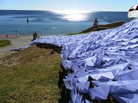 origami lifeboat exactly 1 697 origami boats flow down to the sea