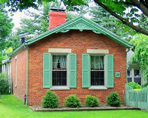 green and brick cottage flickr photo