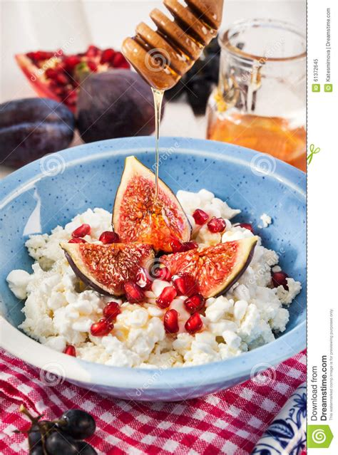 Cottage Cheese And Honey by Cottage Cheese Figs Pomegranate And Honey Stock Photo