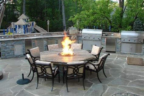 outdoor kitchen with pit table traditional patio