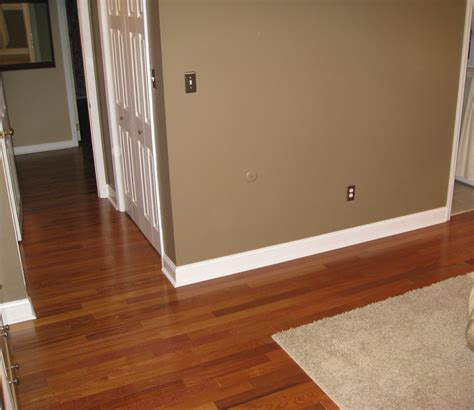 floor white baseboard design ideas with taupe wall plus pergo floors and white wooden door decor