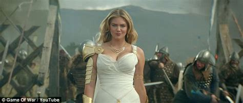 actress game of war commercial kate upton keeps it conservative in black top and pencil