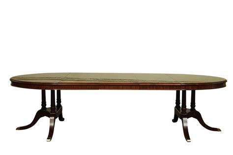 to oval mahogany dining table with leaves sits 12