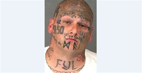 evil smiley tattoo with tattoos arrested for alleged stabbing