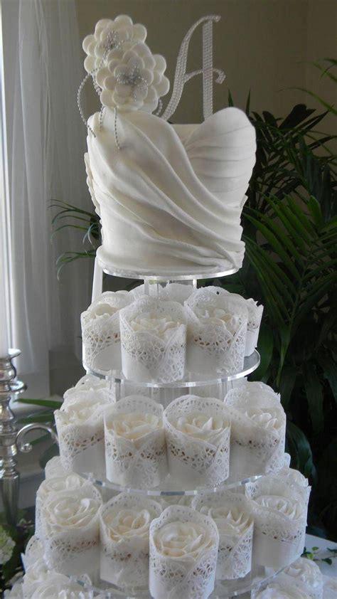 bridal shower cupcake tower wedding dress cupcake tower for bridal shower puck wedding 2475739 weddbook