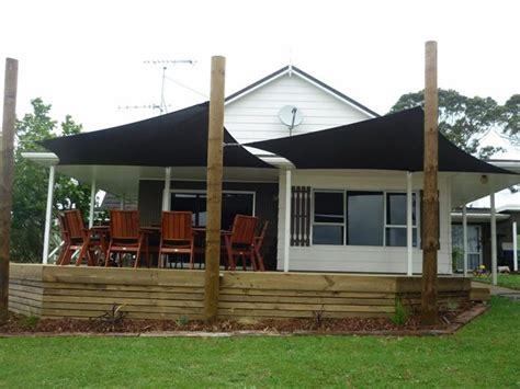 dual shade sails  deck canopy outdoor backyard