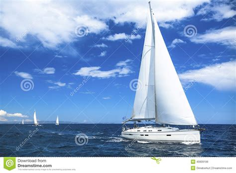 yacht sailing boat difference sailing boat yacht or sail regatta race on blue water sea