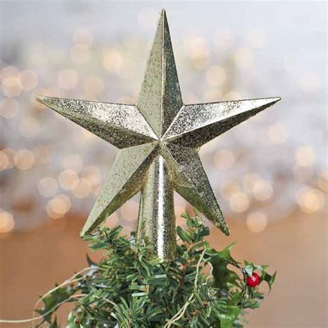small gold glittered star tree topper christmas trees
