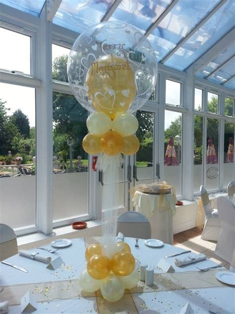 25  best ideas about Balloon centerpieces wedding on