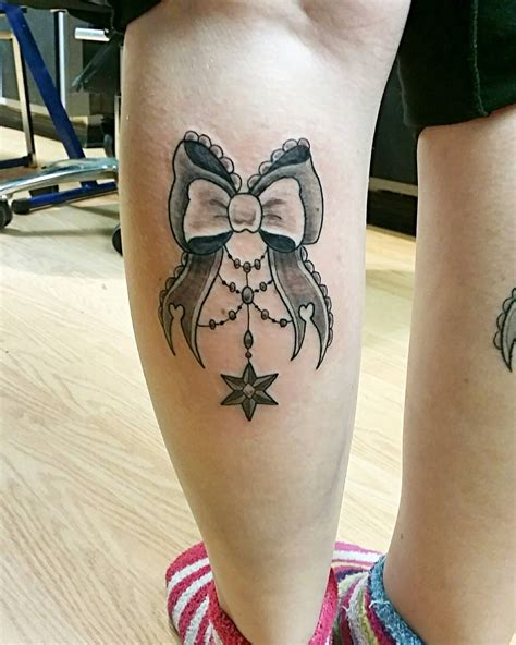 bow tattoos on legs 40 irresistible bow ideas you would want to sport now