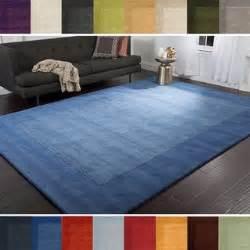 loomed somalia solid bordered tone on tone wool area