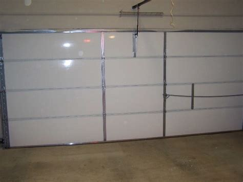 Insulating A Garage Door Energy Efficient Insulated Garage Doors Can Save On Monthly Energy Bills A1 Garage Door