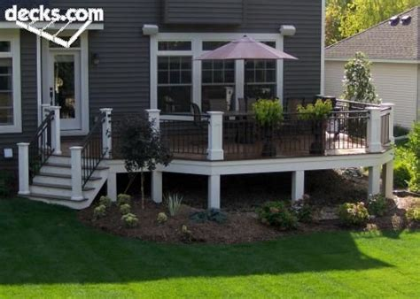 white posts black balasters  railings landscaping