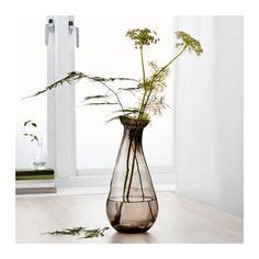 vases flower and pink flowers on